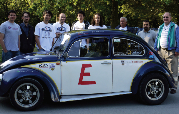 University of British Columbia Electric Car Club president Ricky Gu (third from left) and fellow club memebers pose with their EV modified 1972 VW Beetle, which traveled 14 days and 6400 km across Canada.