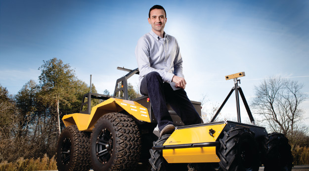 Clearpath Robotics CEO Matt Rendall with the Waterloo-based company's all-terrain Grizzly  RUV.
