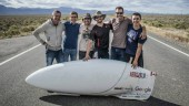 The world's fastest human, Dr. Todd Reichert (center), with AeroVelo co-founder, Cameron Robertson (second from right), and the rest of the team posing with their world record setting speedbike Eta at the 2015 World Human Powered Speed Challenge in Battle Mountain, Nevada.