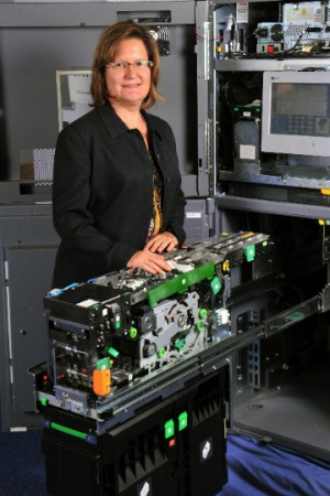 NCR Canada's Director of Engineering Susan Carreon displays her team's Scaleable Deposit Module, an ATM that accepts bills and checks for deposit simultaneously.
