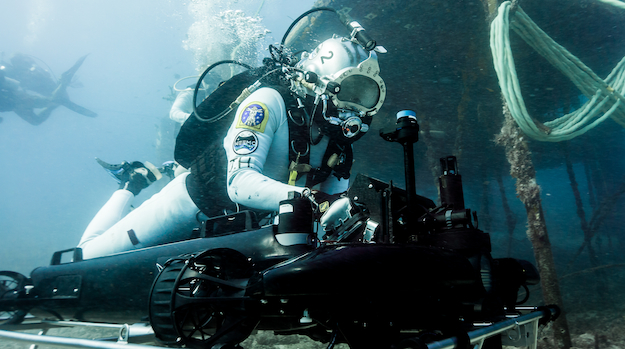 Astronauts working in the NASA Extreme Environment Operations (NEEMO) mission use Shark Marine Technologies' MAKO Diver Delivery System to get around the Aquarius Reef Base underwater habitat and simulate zero gravity environments.